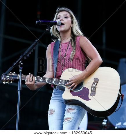 NEW YORK-JUN 26: Country musician Taylor Dye of Maddie & Tae performs onstage at the 2015 FarmBorough Festival - Day 1 at Randall's Island on June 26, 2015 in New York City.