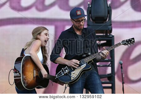 NEW YORK-JUN 26: Country musicians Madison Marlow (L) of Maddie & Tae performs onstage at the 2015 FarmBorough Festival - Day 1 at Randall's Island on June 26, 2015 in New York City.