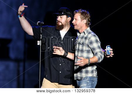 NEW YORK-JUN 26: Country musician Dierks Bentley (R)performs onstage at the 2015 FarmBorough Festival - Day 1 at Randall's Island on June 26, 2015 in New York City.