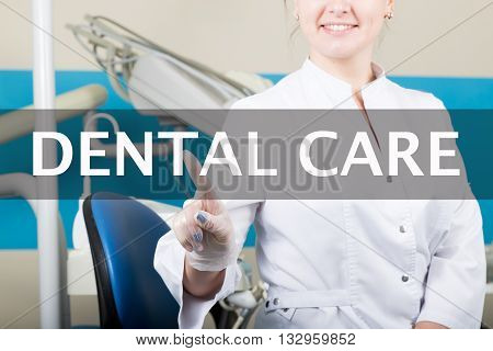 technology, internet and networking in medicine concept - medical doctor presses dental care care button on virtual screens. Internet technologies in medicine.