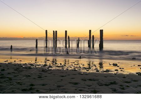 The jetty ruins at Port Willunga South Australia during the golden hour of sunset
