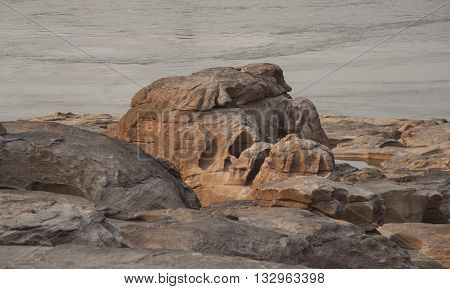 Mekong River Showing Rock Formations Formed By Water Erosion Over Thousands Of Years With Dramatic S