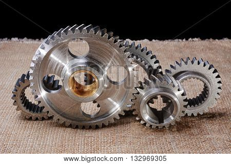 gear wheels cleared of dirt before assembly of the mechanism