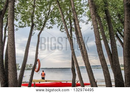 Chelyabinsk, Russia - May 28, 2016: canoes and kayaks on shore lake. far distance for competitions in rowing during Ural championship in rowing