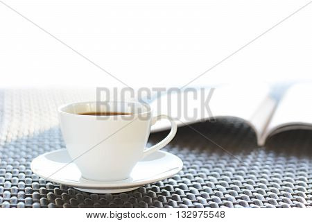 Coffee Cup With Book  On Brown Wicker Table