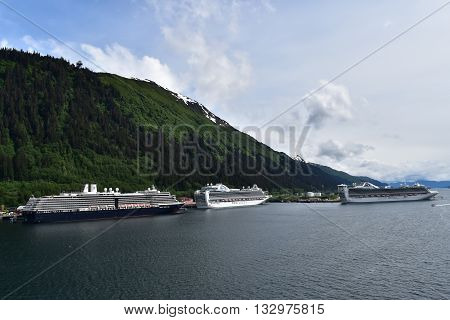 JUNEAU, ALASKA, USA. MAY 18, 2016.  Cruise Ships  of Holland America Line and Princess Cruises docked in front of Mount Roberts.