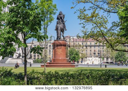 Budapest/HUNGARY, circa April 2016: In front of the Parliament building are the Kossuth Memorial and an equestrian statue of Francis II Rákóczi, as well as a memorial for the 1956 Hungarian Revolution. Unidentified people.