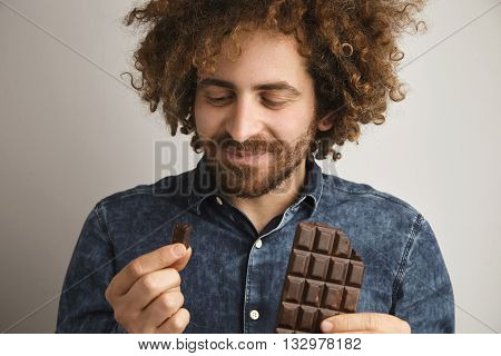 Young Happy Bearded Man With Healthy Skin And Curly Hair Pleasured With Taste Oforganic Freshly Bake
