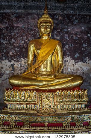 Golden buddhas in Wat Suthat Bangkok Thailand