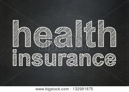 Insurance concept: text Health Insurance on Black chalkboard background