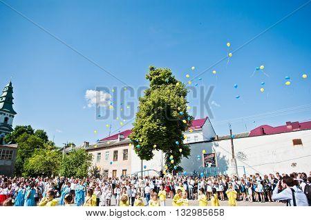 Bila, Ukraine - May 27, 2016: School Line Is In Schoolyard With First-grade Pupils And Teacher. Ball