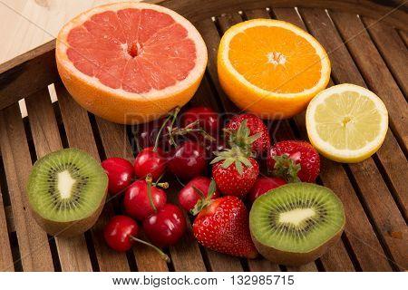 Strawberries, Cherry, Grapes, Kiwi, Orange And Grapefruit On A Plate. Fruit Platter.