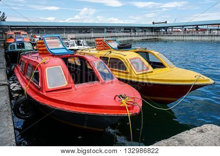 Labuan,Malaysia-Jun 6,2016:Service taxi speedboats Menumbok to Labuan parking at terminal ferry Labuan ready for duty.It is a passenger taxi service operator & tourist attraction in Labuan island.
