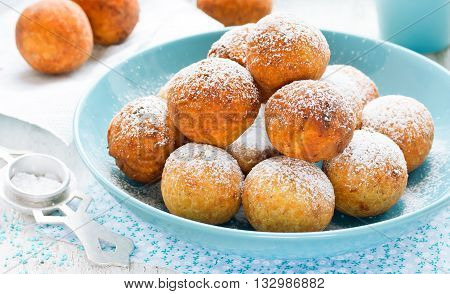 Small donuts with powdered sugar selective focus