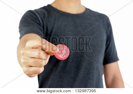 Young man giving condom - sexually transmitted disease control & contraception concepts