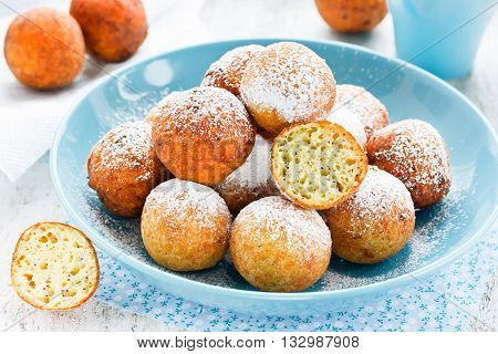 Homemade sponge donuts with powdered sugar selective focus