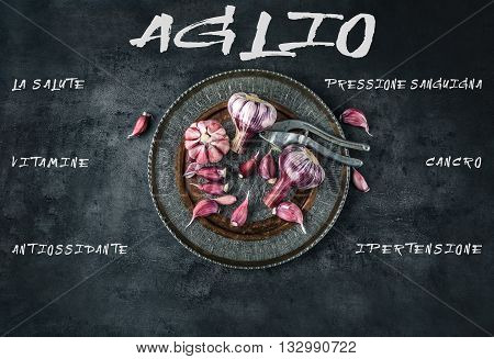 Garlic. Fresh garlic. Red garlic. Garlic press. Violet garlic.Garlic background. garlic bulbs. Medical healt concept. Italian text.
