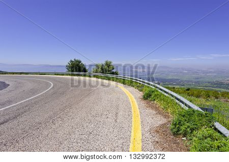 Asphalt Road in the Golan Heights in the Spring