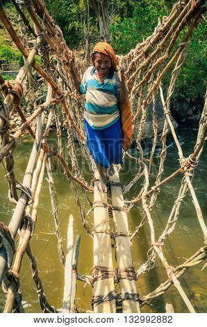 Woman On Bridge In Indonesia
