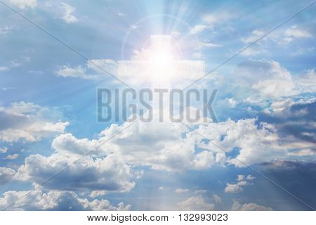 Light From Sky Or Heaven Shine Trough Crucifix Or Cross Form On Pure White Shining Puffy Clouds Sky,