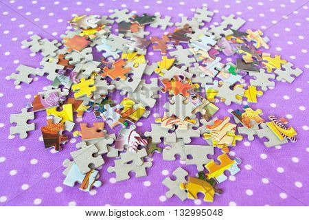 Puzzles on a purple background. Children's puzzle game