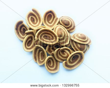 Ear shaped cookies on a white background