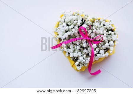 Wedding rings on a bed of flowers