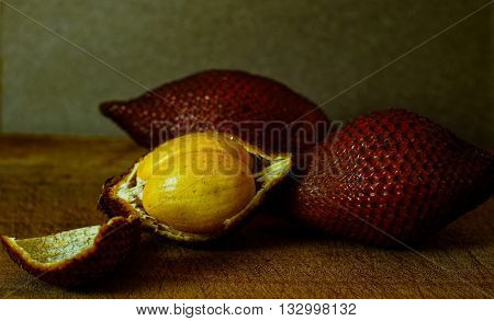 A strange kind of fruit with the skin like dragon scales.