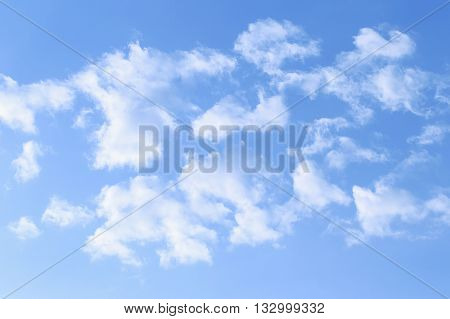 Streaky clouds in the sky with background