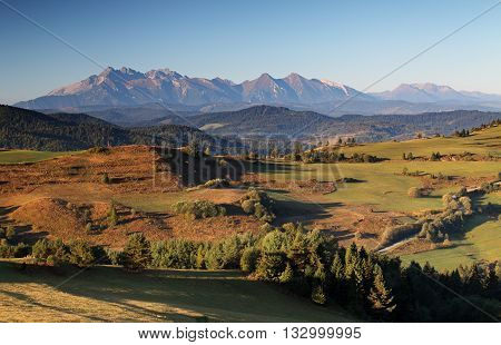 Green spring rural hills landscape Slovakia at day.