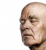Elderly man's face over white background