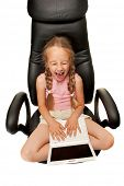 foto of nouns  - Funny young girl with laptop sitting on a chair - JPG