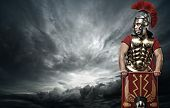 stock photo of legion  - Legionary soldier over stormy sky - JPG