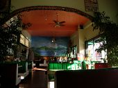 Vinyl Booths With Mural Behind In Mexican Restaurant