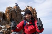 Happy Mountain Tourist On Cliff poster