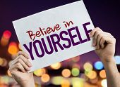Believe in Yourself placard with night lights on background poster