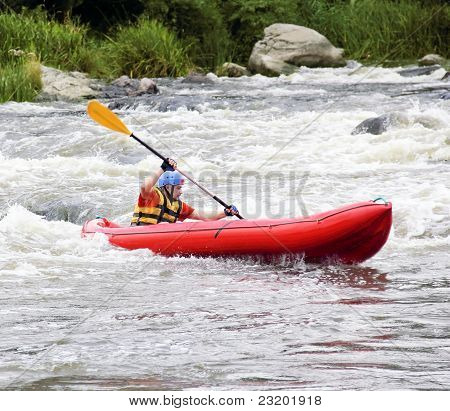 Young Man In Raft On White Water