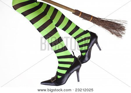 Witch's legs dangling from a broomstick.