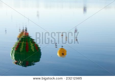 Hot air balloon reflections in water