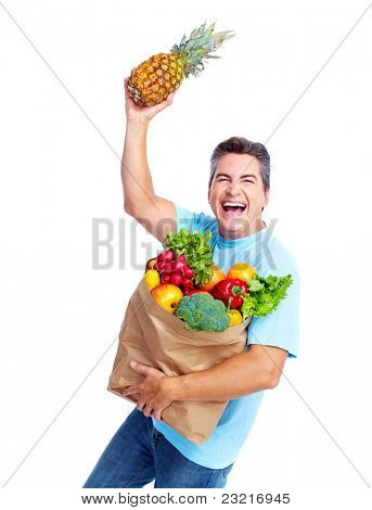 Happy young man with vegetables. Isolated over white.