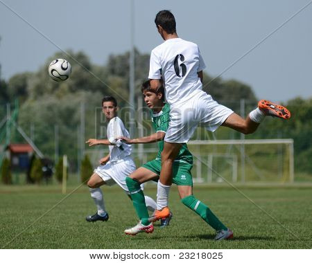 KAPOSVAR, HUNGARY - SEPTEMBER 5: Bence Kovacs (white 6) in action at the Hungarian National Championship under 17 game Kaposvar (white) vs. Nagyatad (green) September 5, 2011 in Kaposvar, Hungary.