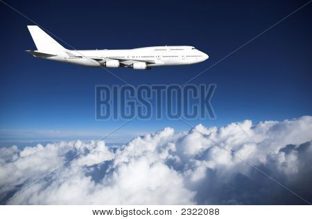 Jumbo Jet  Above Clouds