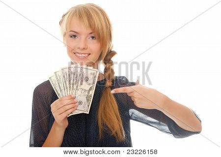 Young Woman Holding In Hand Cash Money Bill American Dollars And Shows Finger On Them