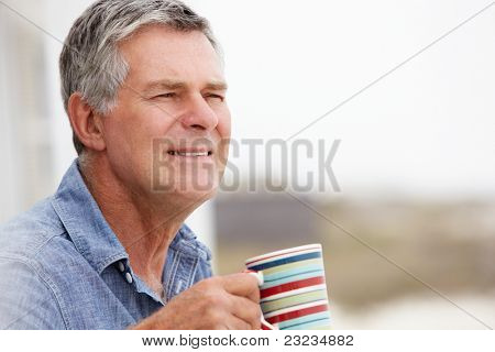 Senior man relaxing outdoors