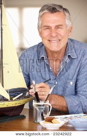 Senior man model making