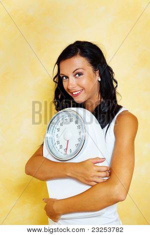 Woman with scales after a successful diet