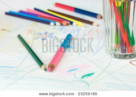 Crayons On A Child's Drawing