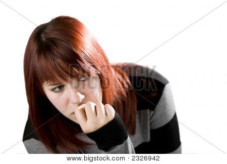 Pensive Redhead Girl Biting Nail