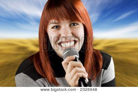 Joyful Girl Singing On The Karaoke