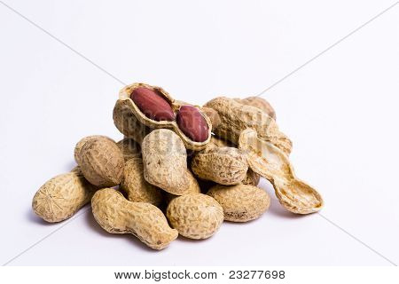 Handful Of Peanuts On A White Background,